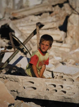 A child amid the rubble of Taflanaz in June, 2012
