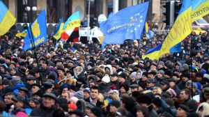 The protests in Kiev.  Note the blue and gold flag of Ukraine alongside the blue with gold stars of Europe.