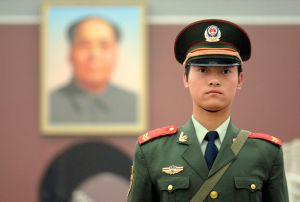 Every story on China has to have a scary looking soldier for a pic.  It seems vaguely racist.