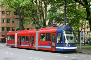 A Skoda 10T operating in Portland. It holds 200 people max, about 50% more than an articulated bus, but fits well on a narrow street.