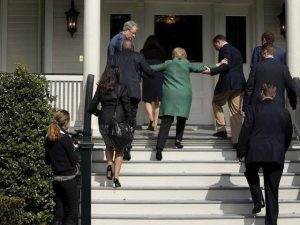 Clinton tripping on the stairs in February - the pic that launched a thousand conspiracy stories.